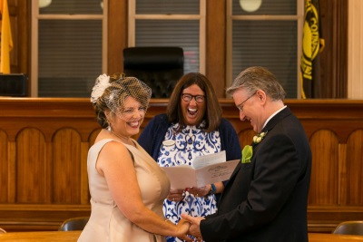 Clerk Melfi recently officiated a wedding ceremony for her staff member Nicole Faust who works in the Search Room at the Hall of Records