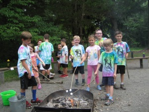 Making s'mores during our spring break camp
